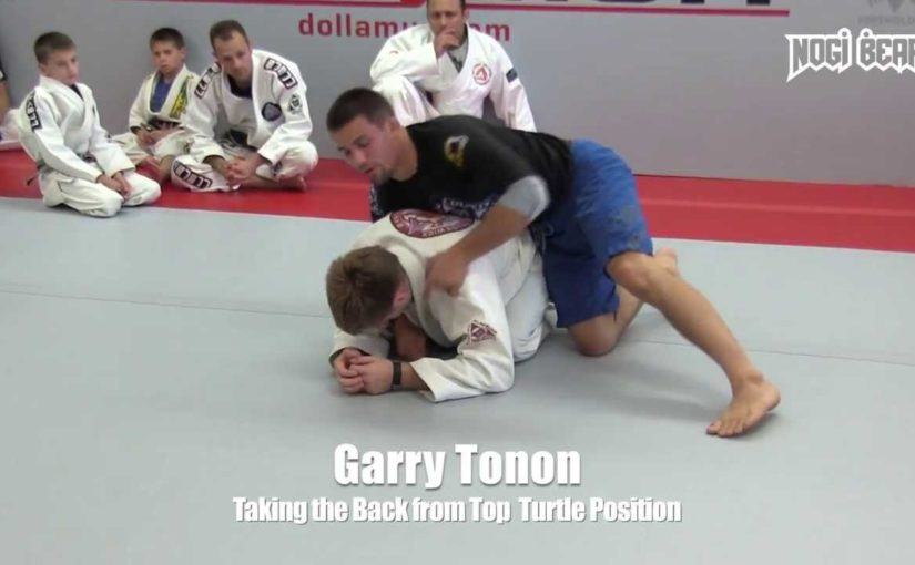 Take the back from turtle position with a forward roll