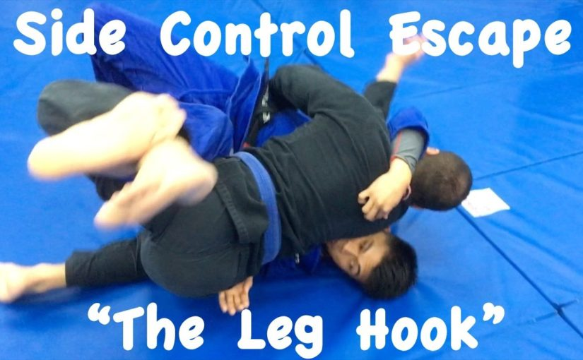 Side control escape by hooking the leg
