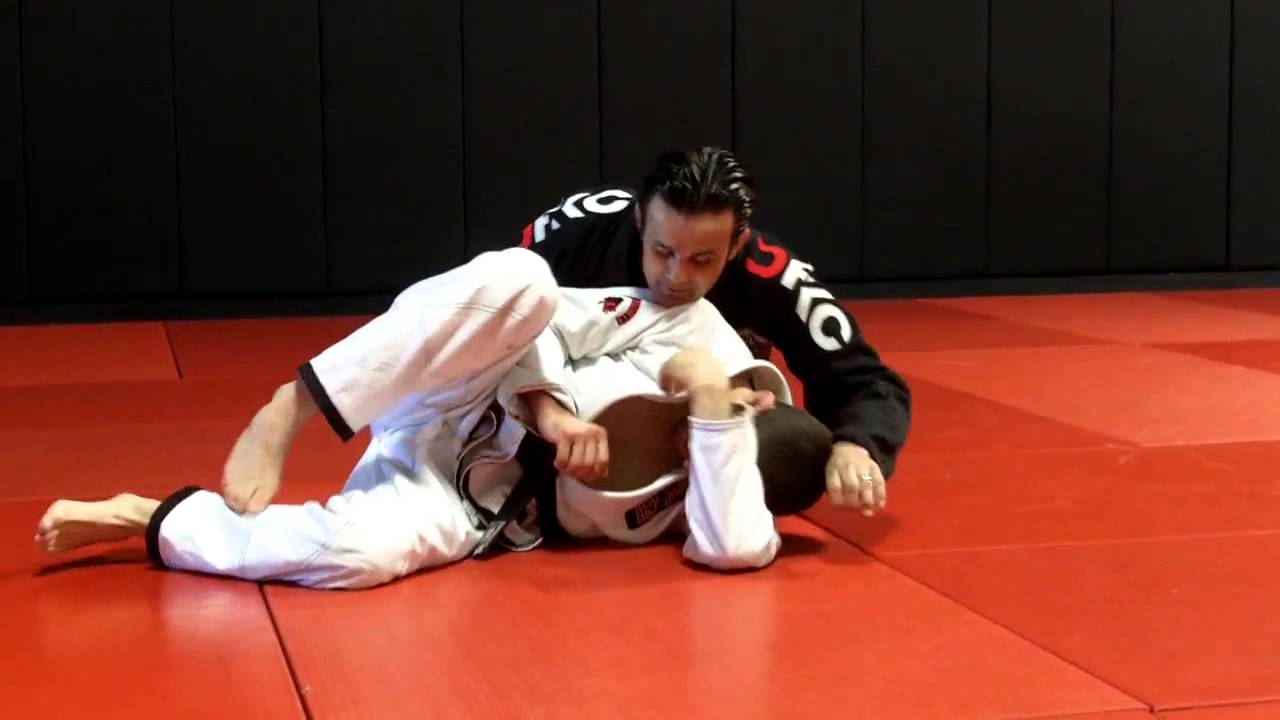 Side control escape by grabbing the head and reversing the position