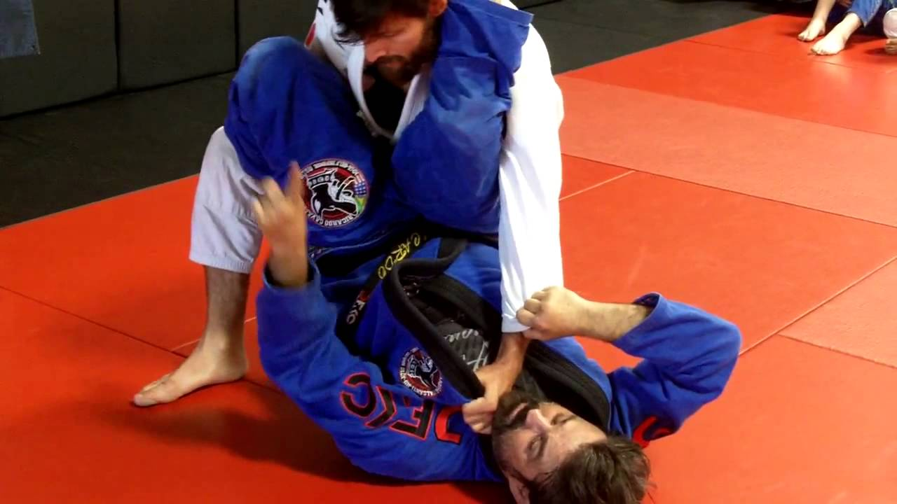 Defend the double underhooks pass and sweep to knee on belly