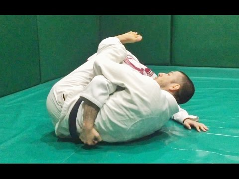 Arm in guillotine choke from the reverse half guard