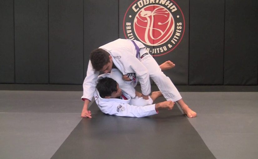 Sit up guard sweep by holding both legs